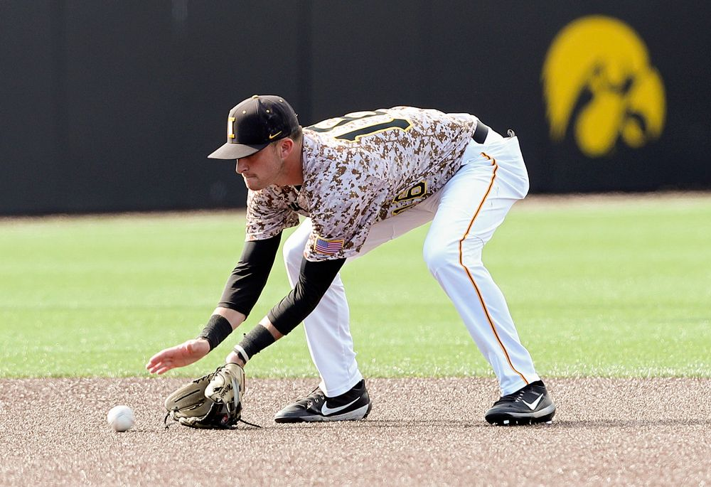 Iowa Hawkeyes shortstop Tanner Wetrich (16) fields a ground ball during the ninth inning of their game against UC Irvine at Duane Banks Field in Iowa City on Sunday, May. 5, 2019. (Stephen Mally/hawkeyesports.com)