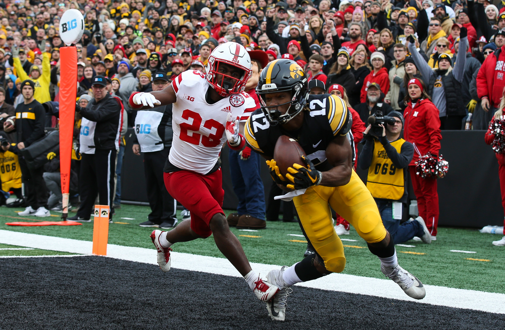 Iowa Hawkeyes wide receiver Brandon Smith (12) makes a touchdown catch during a game against Nebraska at Kinnick Stadium on November 23, 2018. (Tork Mason/hawkeyesports.com)