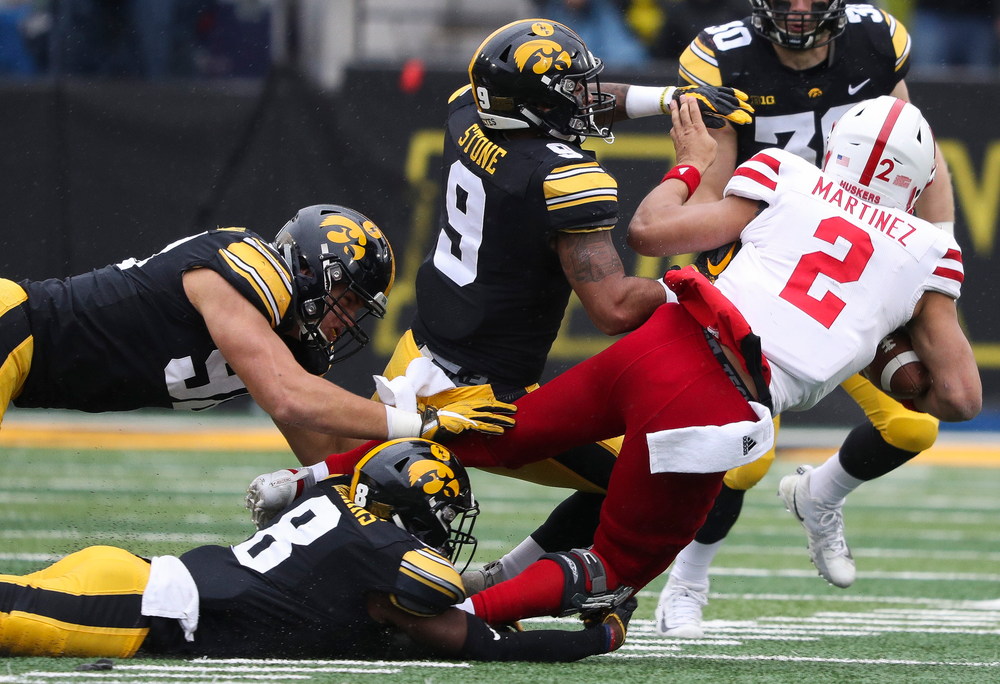 Iowa Hawkeyes defensive back Geno Stone (9) delivers a big hit on the quarterback during a game against Nebraska at Kinnick Stadium on November 23, 2018. (Tork Mason/hawkeyesports.com)