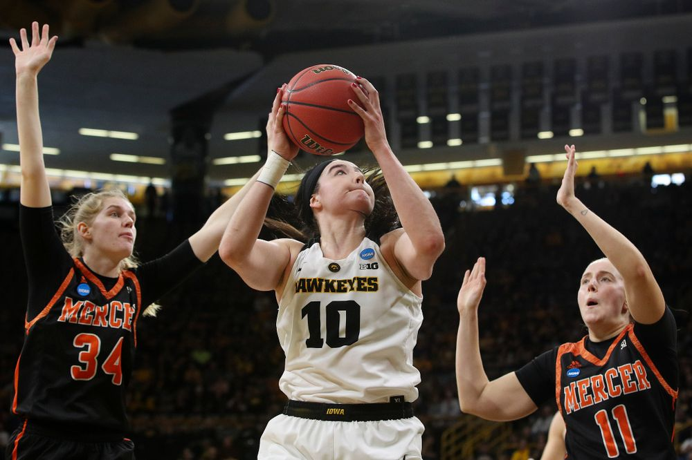 Iowa Hawkeyes forward Megan Gustafson (10) makes a basket between two defenders during the first round of the 2019 NCAA Women's Basketball Tournament at Carver Hawkeye Arena in Iowa City on Friday, Mar. 22, 2019. (Stephen Mally for hawkeyesports.com)