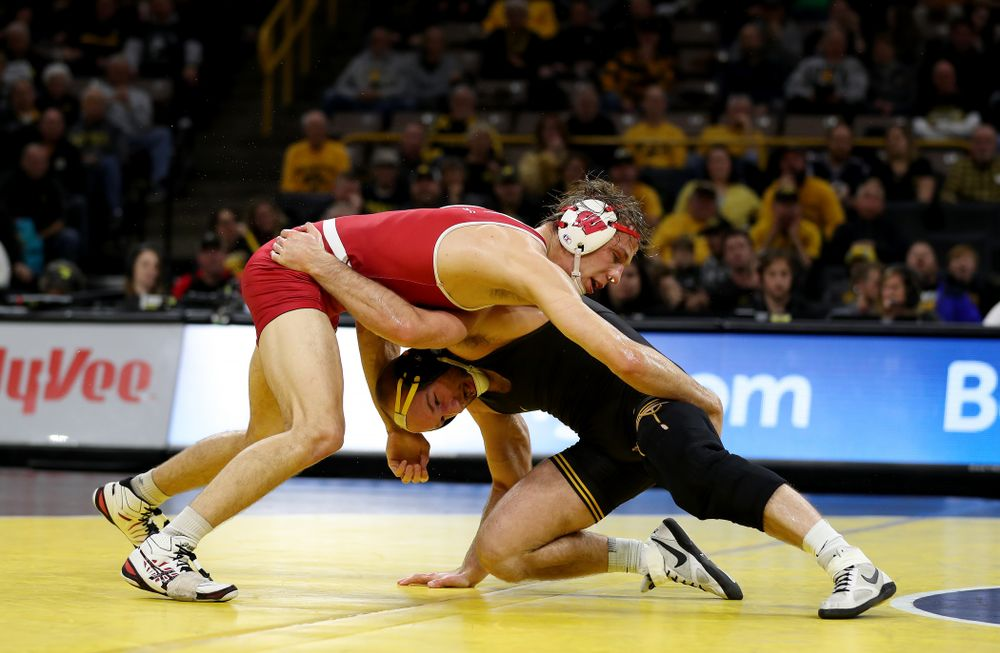 IowaÕs Alex Marinelli wrestles WisconsinÕs Evan Wick at 165 pounds Sunday, December 1, 2019 at Carver-Hawkeye Arena. Marinelli won the match 4-2. (Brian Ray/hawkeyesports.com)
