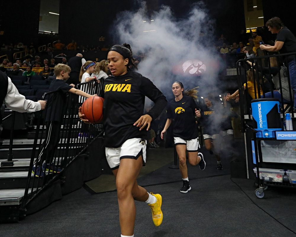 Iowa Hawkeyes guard Alexis Sevillian (5) leads her team onto the court before their game at Carver-Hawkeye Arena in Iowa City on Tuesday, December 31, 2019. (Stephen Mally/hawkeyesports.com)
