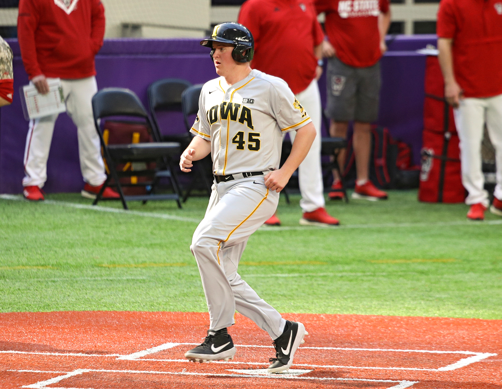 Iowa Hawkeyes first baseman Peyton Williams (45) scores a run during the seventh inning of their CambriaCollegeClassic game at U.S. Bank Stadium in Minneapolis, Minn. on Friday, February 28, 2020. (Stephen Mally/hawkeyesports.com)