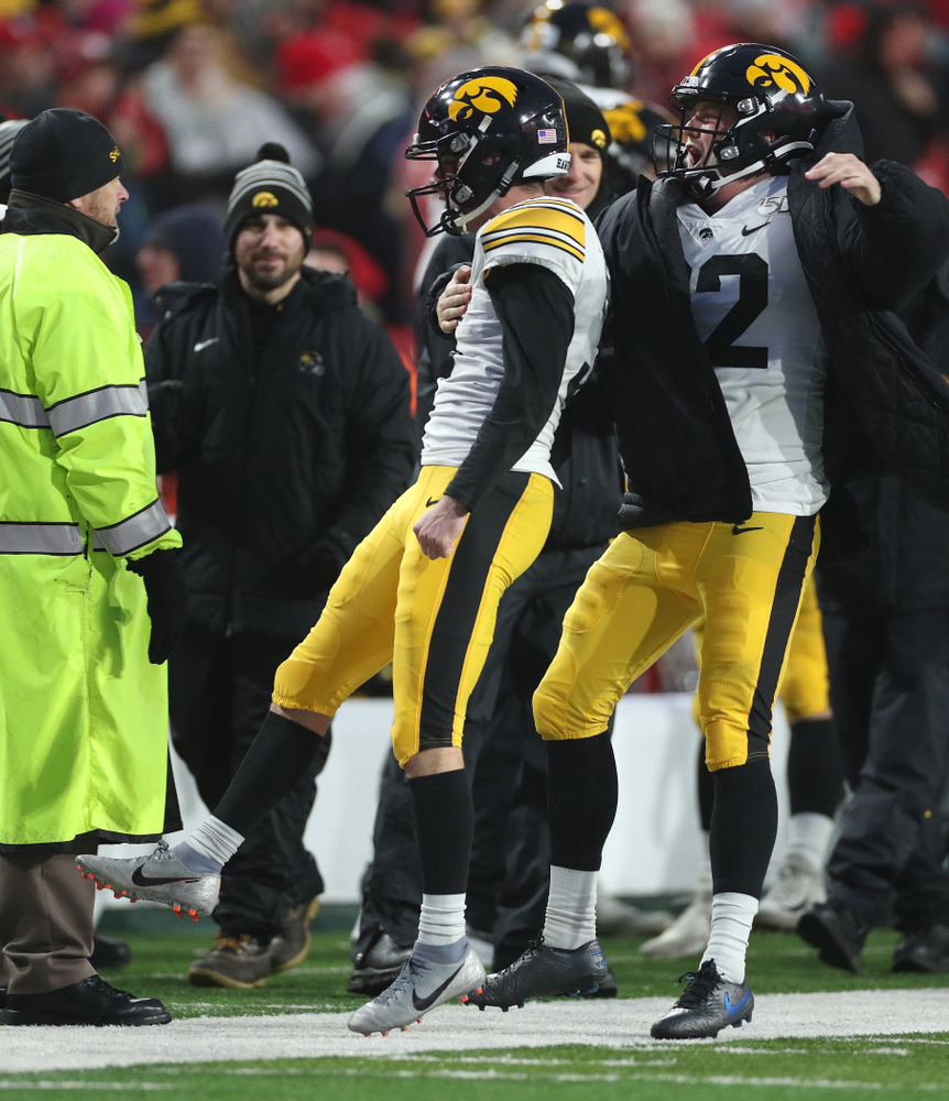 Iowa Hawkeyes place kicker Keith Duncan (3) celebrates with punter Michael Sleep-Dalton (22) after kicking the game winning field goal against the Nebraska Cornhuskers Friday, November 29, 2019 at Memorial Stadium in Lincoln, Neb. (Brian Ray/hawkeyesports.com)