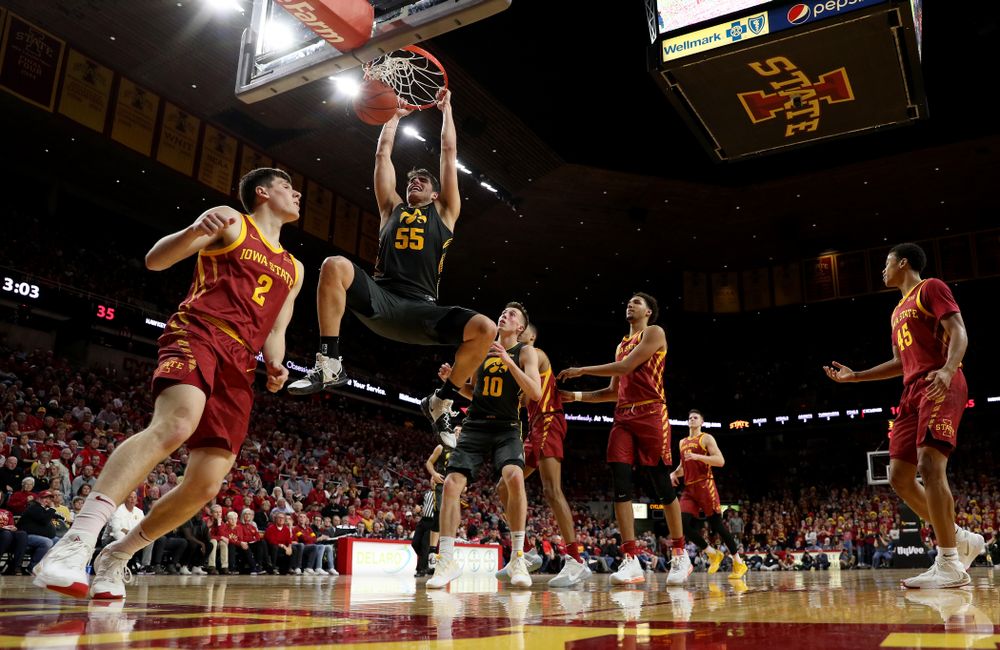 Iowa Hawkeyes forward Luka Garza (55) dunks the ball against the Iowa State Cyclones Thursday, December 12, 2019 at Hilton Coliseum in Ames, Iowa(Brian Ray/hawkeyesports.com)