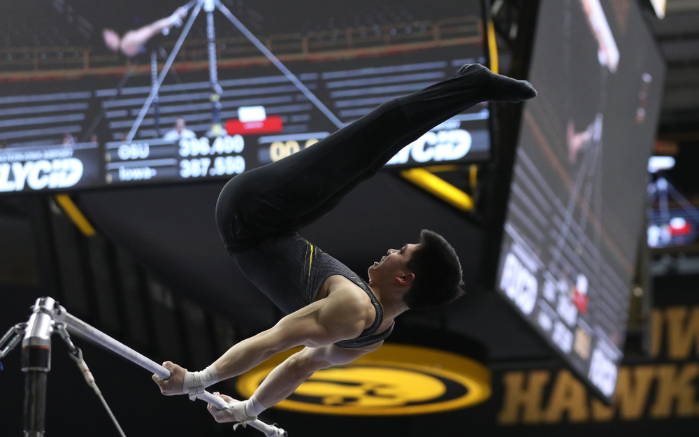 Iowa's Bennet Huang competes on the high bar against the Ohio State Buckeyes Saturday, March 16, 2019 at Carver-Hawkeye Arena.  (Brian Ray/hawkeyesports.com)