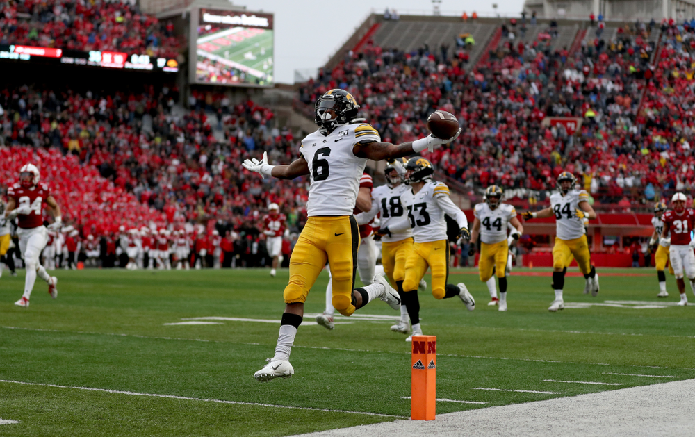 Iowa Hawkeyes wide receiver Ihmir Smith-Marsette (6) returns a kickoff for a touchdown against the Nebraska Cornhuskers Friday, November 29, 2019 at Memorial Stadium in Lincoln, Neb. (Brian Ray/hawkeyesports.com)