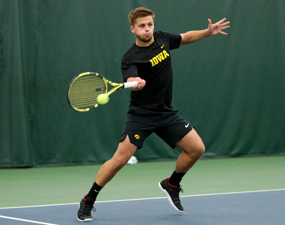 Iowa's Will Davies returns a shot during his doubles match at the Hawkeye Tennis and Recreation Complex in Iowa City on Thursday, January 16, 2020. (Stephen Mally/hawkeyesports.com)