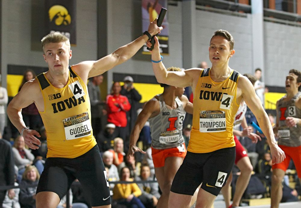 Iowa's Spencer Gudgel (from left) takes the baton from Chris Thompson runs the men's 1600 meter relay premier event during the Larry Wieczorek Invitational at the Recreation Building in Iowa City on Saturday, January 18, 2020. (Stephen Mally/hawkeyesports.com)