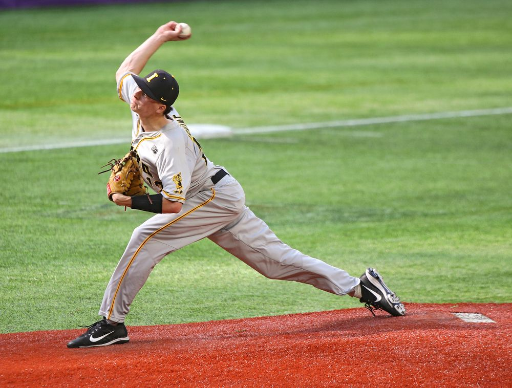 Iowa Hawkeyes pitcher Drew Irvine (12) delivers to the plate during the sixth inning of their CambriaCollegeClassic game at U.S. Bank Stadium in Minneapolis, Minn. on Friday, February 28, 2020. (Stephen Mally/hawkeyesports.com)