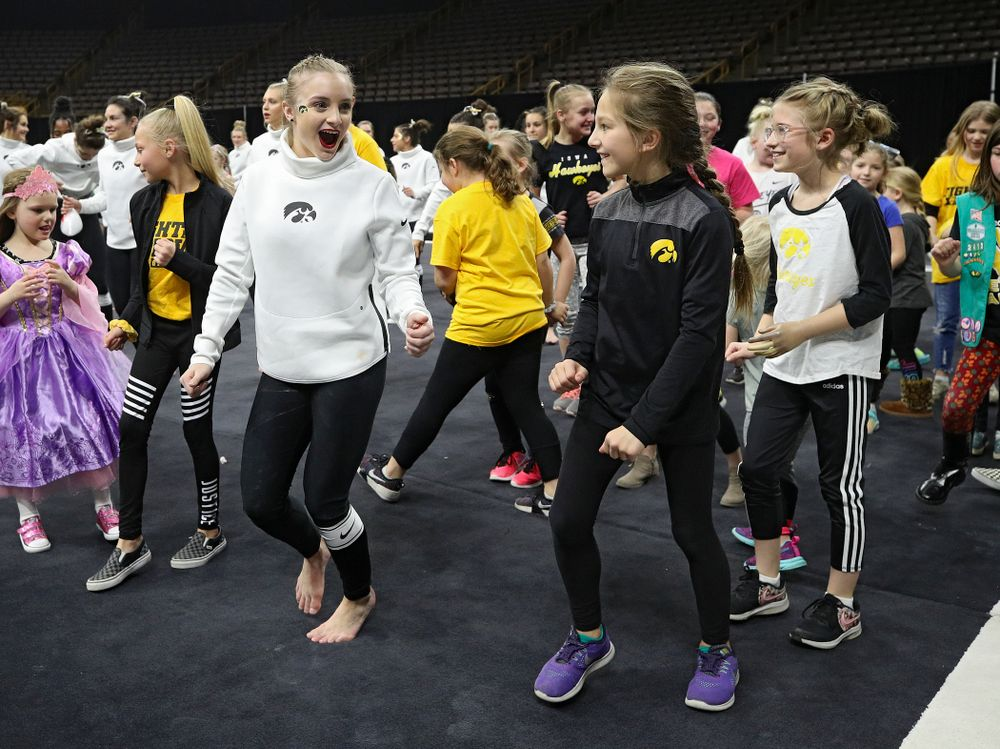 Iowa's Lauren Guerin dances the Cha-Cha Slide with fans after their meet at Carver-Hawkeye Arena in Iowa City on Sunday, March 8, 2020. (Stephen Mally/hawkeyesports.com)