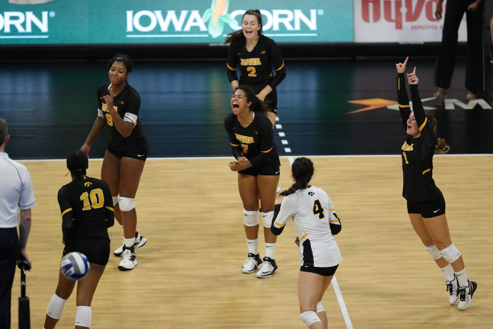 The Iowa Hawkeyes celebrate a point against the Iowa State Cyclones Saturday, September 21, 2019 during the Iowa Corn Cy-Hawk Series Tournament at Carver-Hawkeye Arena. (Brian Ray/hawkeyesports.com)