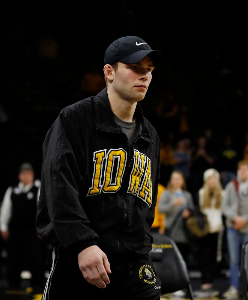 Iowa's senior Brandon Sorensen is recognized following their meet against Northwestern