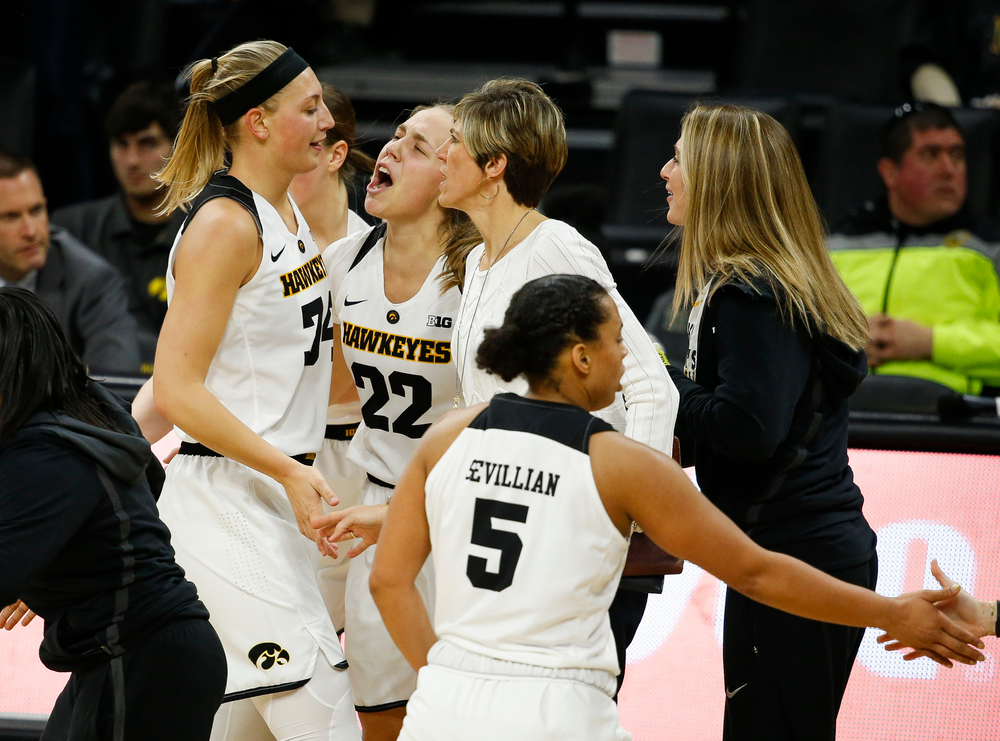 Iowa Hawkeyes forward Carly Mohns (34), Iowa Hawkeyes guard Kathleen Doyle (22), Iowa Hawkeyes assistant coach Jan Jensen