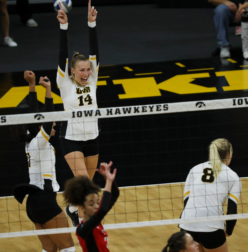 Iowa Hawkeyes outside hitter Cali Hoye (14) celebrates after winning a point during a match against Rutgers at Carver-Hawkeye Arena on November 2, 2018. (Tork Mason/hawkeyesports.com)