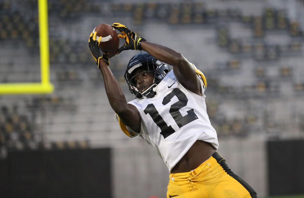 Iowa Hawkeyes defensive back D.J. Johnson (12)