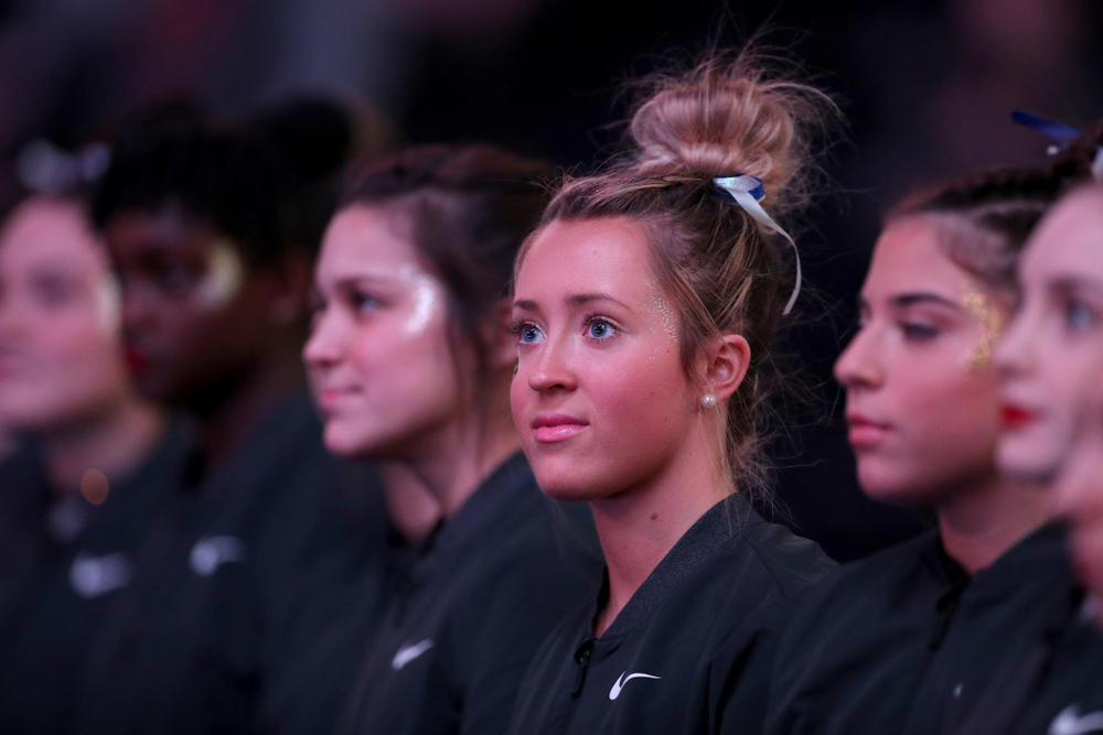 Iowa's Maddie Kampschroeder stands for the National Anthem before their meet against Michigan State Saturday, February 1, 2020 at Carver-Hawkeye Arena. (Brian Ray/hawkeyesports.com)