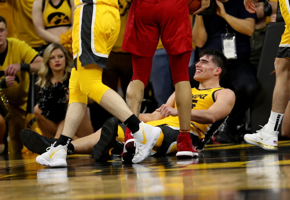 Iowa Hawkeyes forward Luka Garza (55) smiles after drawing a charging foul against the Rutgers Scarlet Knights  Wednesday, January 22, 2020 at Carver-Hawkeye Arena. (Brian Ray/hawkeyesports.com)