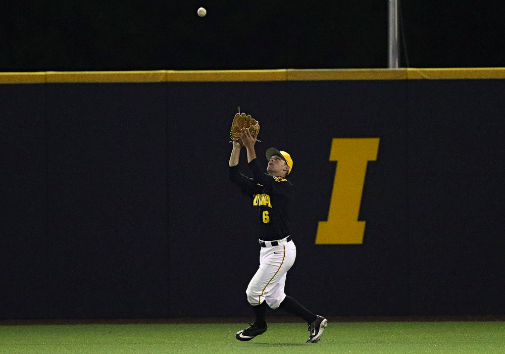 Iowa Hawkeyes center fielder Justin Jenkins (6) pulls in a fly ball for an out during the eighth inning of their game against Western Illinois at Duane Banks Field in Iowa City on Wednesday, May. 1, 2019. (Stephen Mally/hawkeyesports.com)