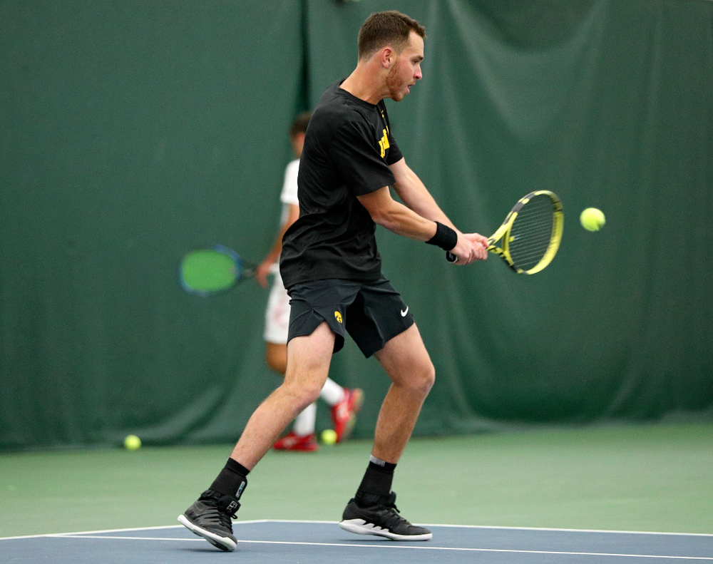 Iowa's Kareem Allaf returns a shot during their match at the Hawkeye Tennis and Recreation Complex in Iowa City on Thursday, January 16, 2020. (Stephen Mally/hawkeyesports.com)