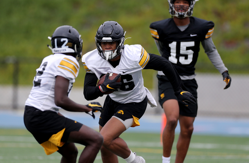 Iowa Hawkeyes defensive back Kaevon Merriweather (26) intercepts a pass during practice Sunday, December 22, 2019 at Mesa Community College in San Diego. (Brian Ray/hawkeyesports.com)