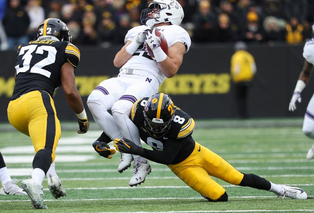 Iowa Hawkeyes defensive back Matt Hankins (8) makes a tackle during a game against Northwestern at Kinnick Stadium on November 10, 2018. (Tork Mason/hawkeyesports.com)