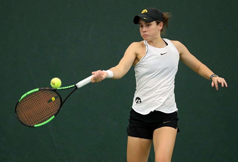 Iowa's Elise Van Heuvelen returns a shot during her singles match at the Hawkeye Tennis and Recreation Complex in Iowa City on Sunday, February 16, 2020. (Stephen Mally/hawkeyesports.com)