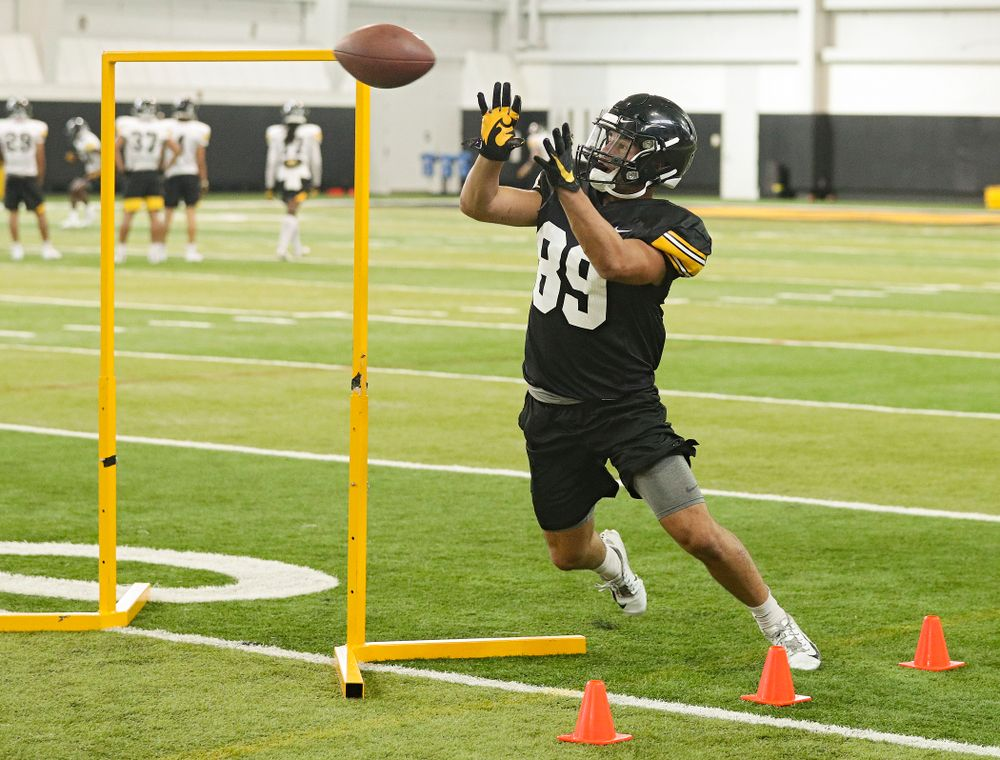 Iowa Hawkeyes wide receiver Nico Ragaini (89) pulls in a pass during Fall Camp Practice No. 9 at the Hansen Football Performance Center in Iowa City on Monday, Aug 12, 2019. (Stephen Mally/hawkeyesports.com)