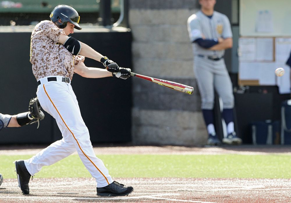 Iowa Hawkeyes right fielder Connor McCaffery (30) hits an RBI single during the eighth inning of their game against UC Irvine at Duane Banks Field in Iowa City on Sunday, May. 5, 2019. (Stephen Mally/hawkeyesports.com)
