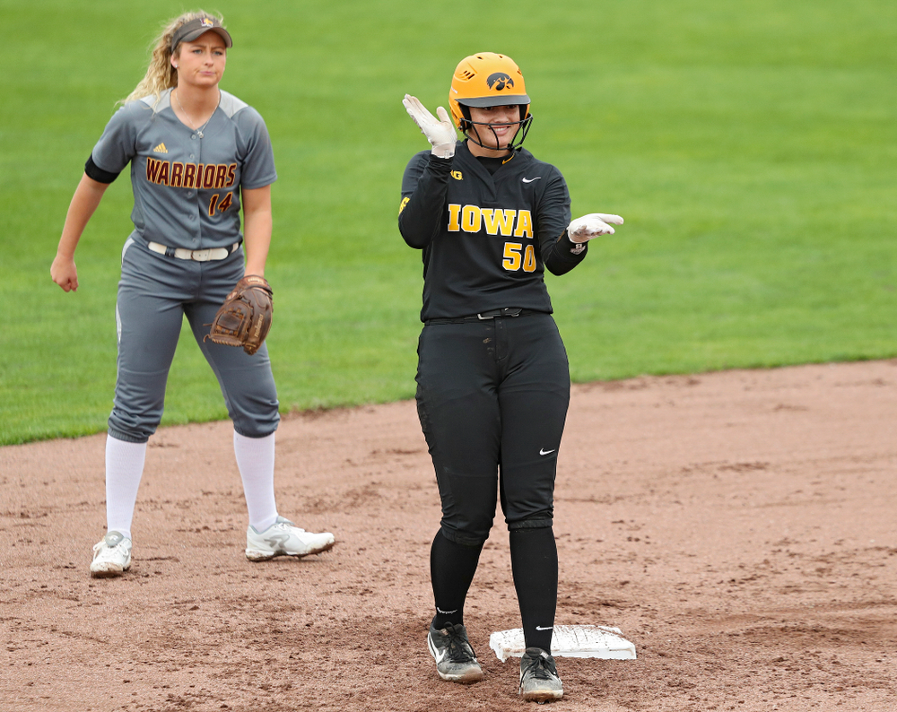 Iowa infielder Kalena Burns (50) celebrates after hitting a double during the fourth inning of their game against Iowa Softball vs Indian Hills Community College at Pearl Field in Iowa City on Sunday, Oct 6, 2019. (Stephen Mally/hawkeyesports.com)