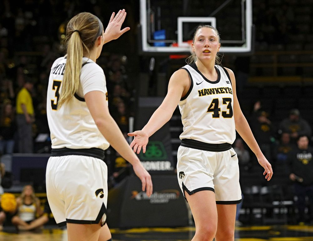 Iowa Hawkeyes guard Makenzie Meyer (3) celebrates with forward Amanda Ollinger (43) in the closing seconds of the fourth quarter of the game at Carver-Hawkeye Arena in Iowa City on Thursday, February 6, 2020. (Stephen Mally/hawkeyesports.com)