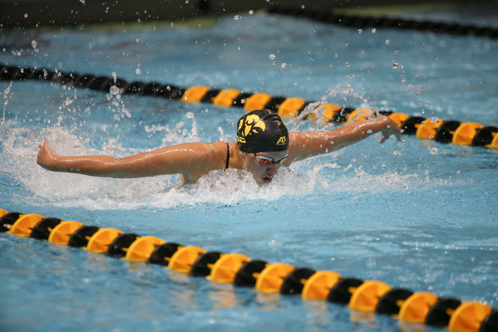 Iowa's Christina Kauffman swims the 100-yard butterfly during the Iowa swimming and diving meet vs Notre Dame and Illinois on Saturday, January 11, 2020 at the Campus Recreation and Wellness Center. (Lily Smith/hawkeyesports.com)