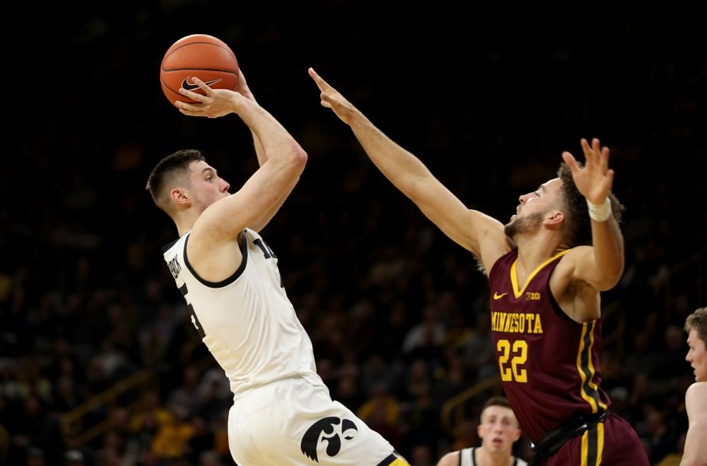 Iowa Hawkeyes guard CJ Fredrick (5) pulls up for a shot against the Minnesota Golden Gophers Monday, December 9, 2019 at Carver-Hawkeye Arena. (Brian Ray/hawkeyesports.com)