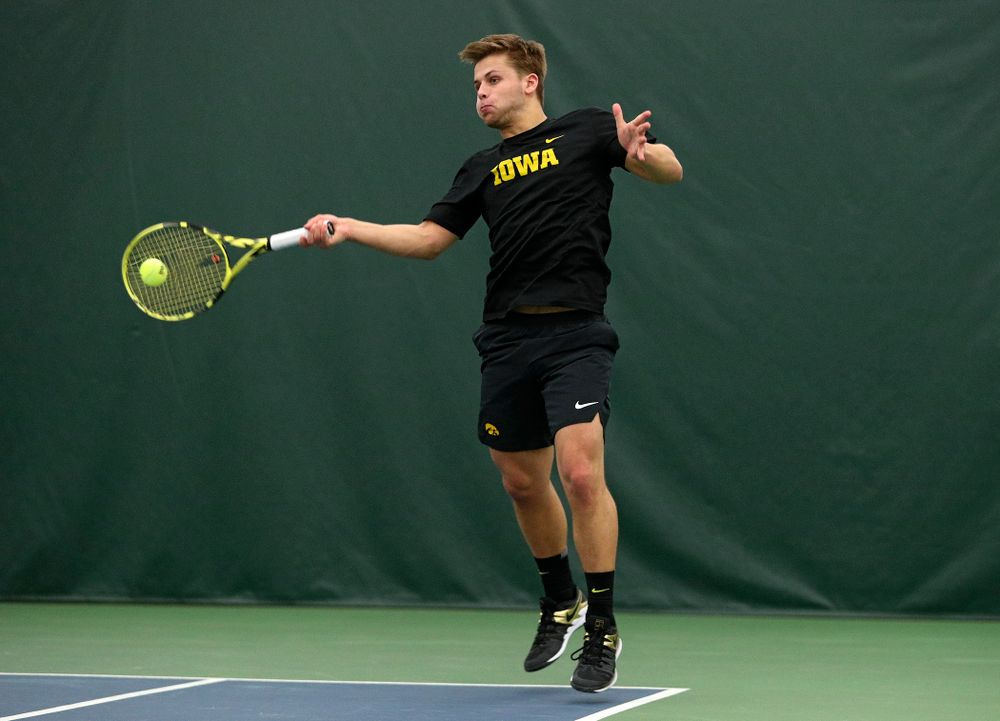 Iowa's Will Davies returns a shot during his singles match at the Hawkeye Tennis and Recreation Complex in Iowa City on Friday, March 6, 2020. (Stephen Mally/hawkeyesports.com)