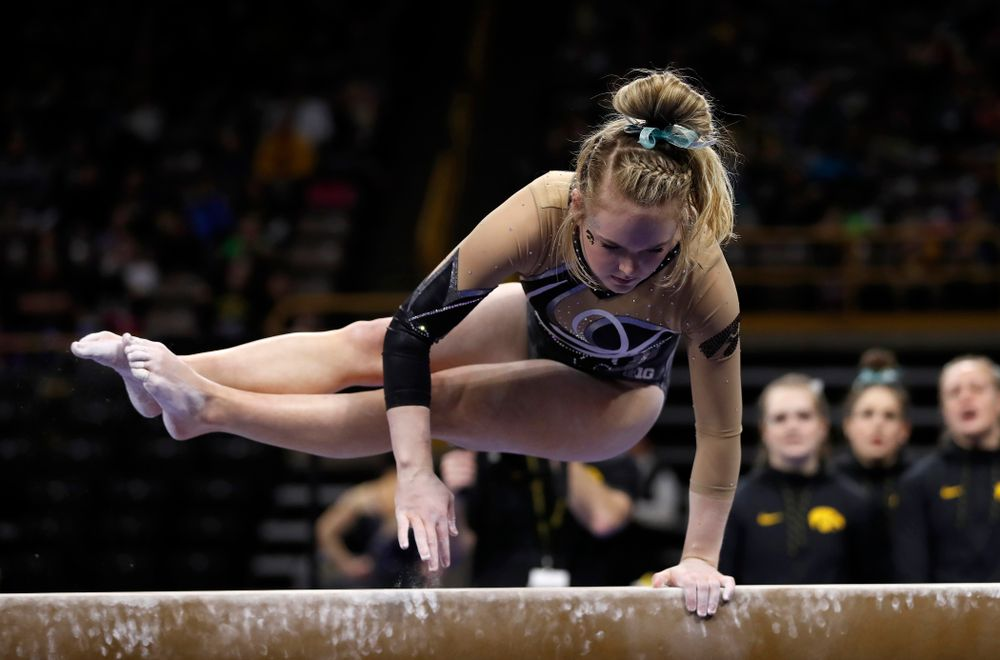 Iowa's Charlotte Sullivan competes on the beam against the Nebraska Cornhuskers