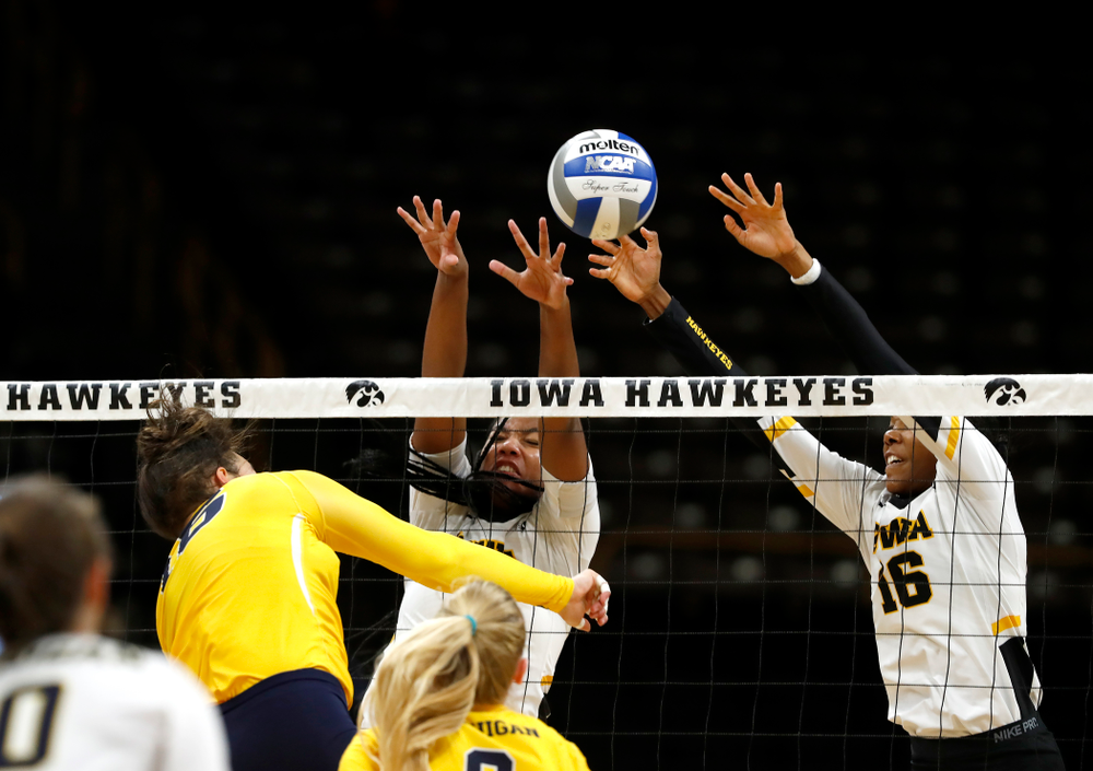 Iowa Hawkeyes middle blocker Amiya Jones (9) and outside hitter Taylor Louis (16) against the Michigan Wolverines Sunday, September 23, 2018 at Carver-Hawkeye Arena. (Brian Ray/hawkeyesports.com)