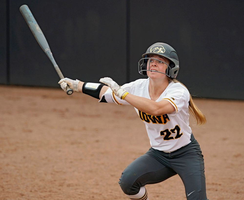 Iowa Hawkeyes Hallie Ketcham (22) drives a pitch for a hit during the sixth inning of their Big Ten Conference softball game at Pearl Field in Iowa City on Friday, Mar. 29, 2019. (Stephen Mally/hawkeyesports.com)