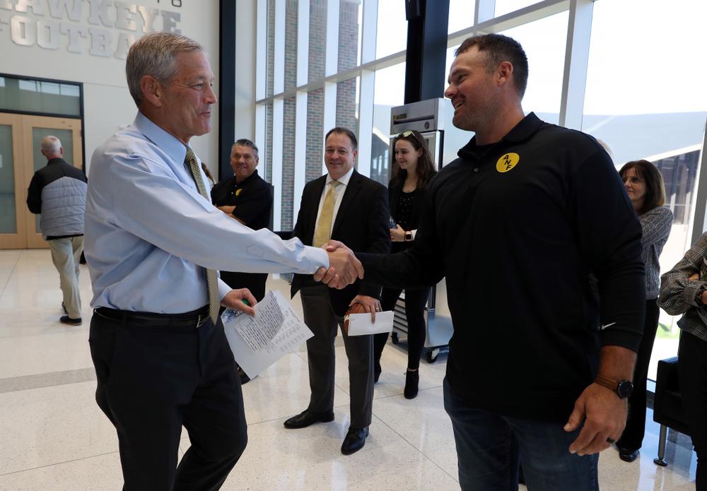 ANF Honoree Matt Kroul shakes hands with Iowa Hawkeyes head coach Kirk Ferentz Tuesday, October 8, 2019 at the Hansen Football Performance Center. (Brian Ray/hawkeyesports.com)