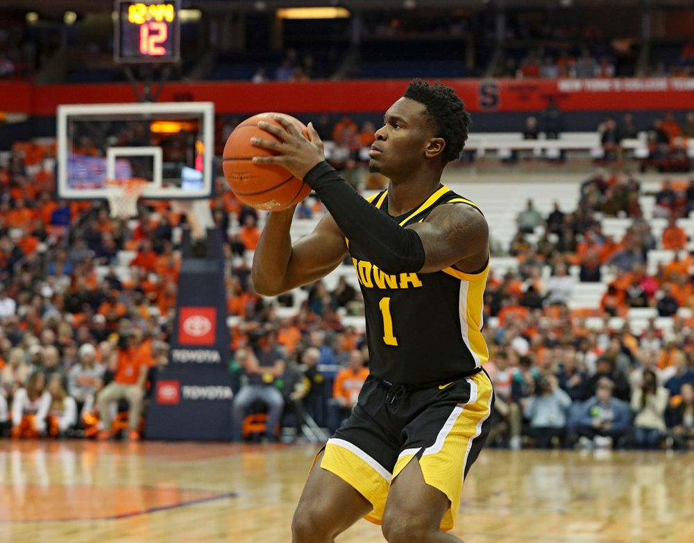 Iowa Hawkeyes guard Joe Toussaint (1) lines up a shot during the first half of their ACC/Big Ten Challenge game at the Carrier Dome in Syracuse, N.Y. on Tuesday, Dec 3, 2019. (Stephen Mally/hawkeyesports.com)