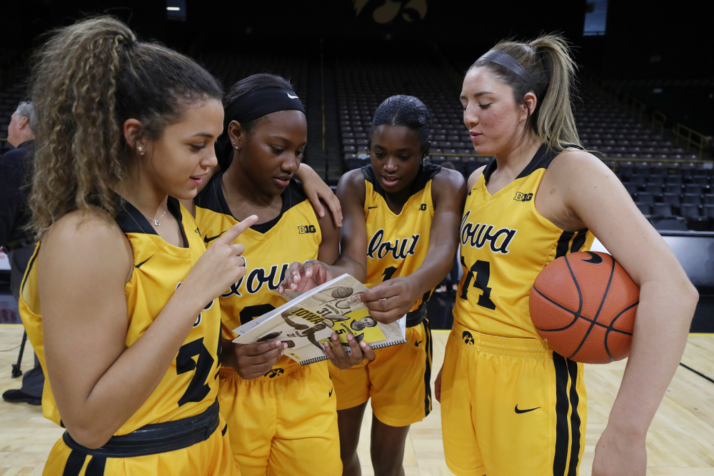 Iowa Hawkeyes guard Gabbie Marshall (24), guard Zion Sanders (21), guard Tomi Taiwo  (1), and guard Megan Meyer (11) during the teamÕs annual media day Thursday, October 24, 2019 at Carver-Hawkeye Arena. (Brian Ray/hawkeyesports.com)