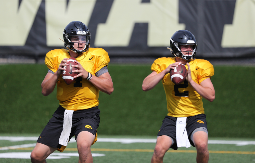 Iowa Hawkeyes quarterback Nate Stanley (4) and quarterback Peyton Mansell (2) during Fall Camp Practice No. 4 Monday, August 5, 2019 at the Ronald D. and Margaret L. Kenyon Football Practice Facility. (Brian Ray/hawkeyesports.com)