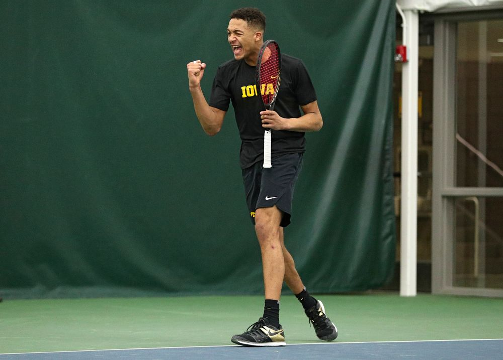 Iowa's Oliver Okonkwo celebrates a point during his singles match at the Hawkeye Tennis and Recreation Complex in Iowa City on Friday, February 14, 2020. (Stephen Mally/hawkeyesports.com)