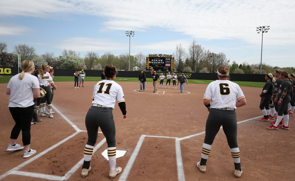 The fathers of seniors Brooke Rozier, Mallory Kilian (11), and Erin Riding throw out a first pitch against the Ohio State Buckeyes on senior day Sunday, May 5, 2019 at Pearl Field. (Brian Ray/hawkeyesports.com)