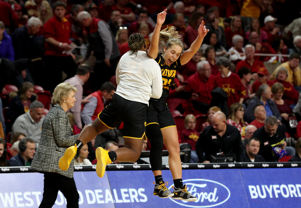 Iowa Hawkeyes guard Kathleen Doyle (22) celebrates with Iowa Hawkeyes guard Zion Sanders (21) at the end of the game against the Iowa State Cyclones Wednesday, December 11, 2019 at Hilton Coliseum in Ames, Iowa(Brian Ray/hawkeyesports.com)