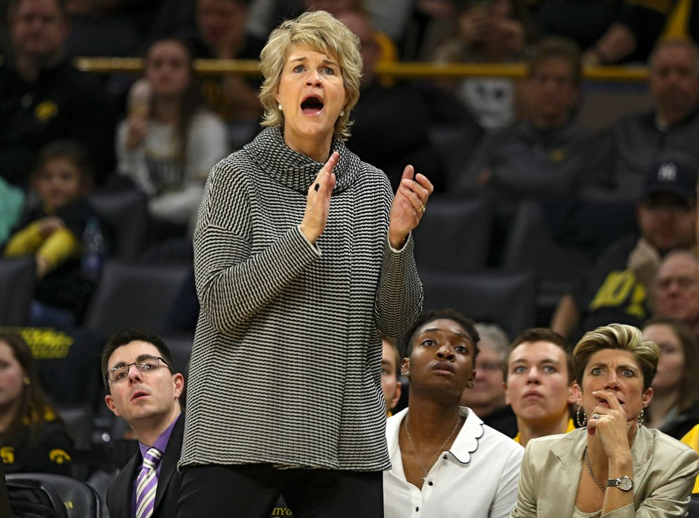Iowa Hawkeyes head coach Lisa Bluder urges on her team during the third quarter of their game at Carver-Hawkeye Arena in Iowa City on Tuesday, December 31, 2019. (Stephen Mally/hawkeyesports.com)