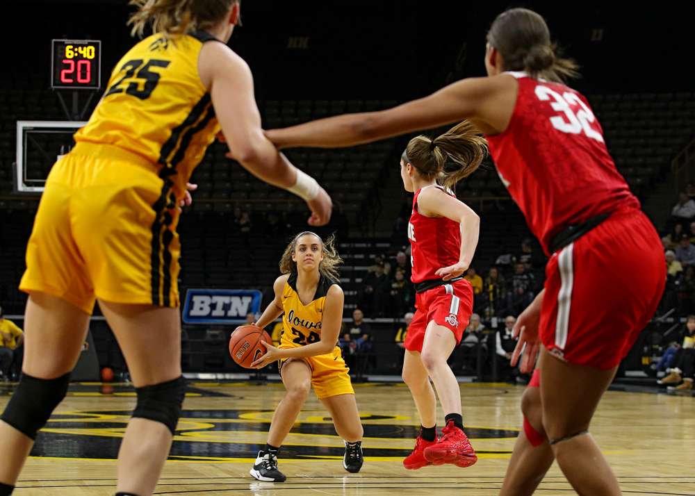 Iowa Hawkeyes guard Gabbie Marshall (24) looks to pass during the first quarter of their game at Carver-Hawkeye Arena in Iowa City on Thursday, January 23, 2020. (Stephen Mally/hawkeyesports.com)