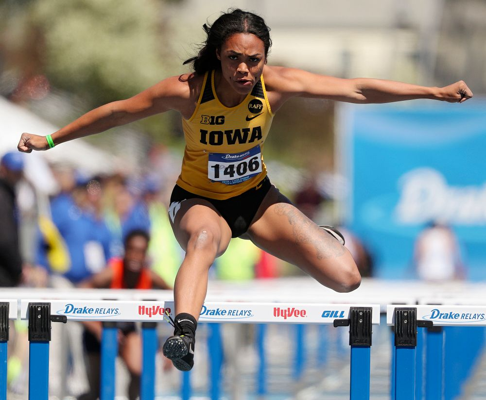 Iowa's Tria Simmons runs the women's 100 meter hurdles event during the second day of the Drake Relays at Drake Stadium in Des Moines on Friday, Apr. 26, 2019. (Stephen Mally/hawkeyesports.com)