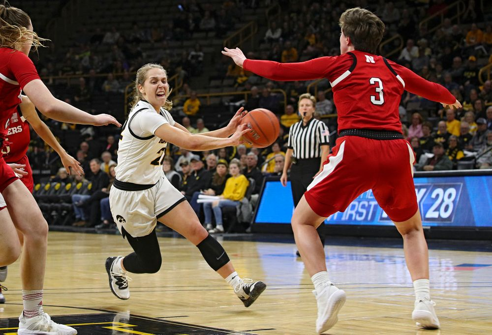 Iowa Hawkeyes guard Kathleen Doyle (22) passes the ball to guard Alexis Sevillian (not pictured) for an assist as Sevillian made a 3-pointer during the first quarter of the game at Carver-Hawkeye Arena in Iowa City on Thursday, February 6, 2020. (Stephen Mally/hawkeyesports.com)