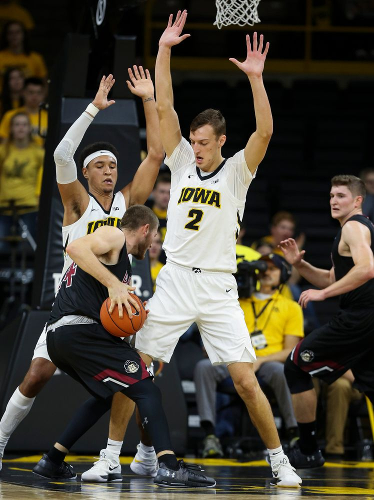 Iowa Hawkeyes forward Cordell Pemsl (35) and Iowa Hawkeyes forward Jack Nunge (2) defend in the paint during a game against Guilford College at Carver-Hawkeye Arena on November 4, 2018. (Tork Mason/hawkeyesports.com)