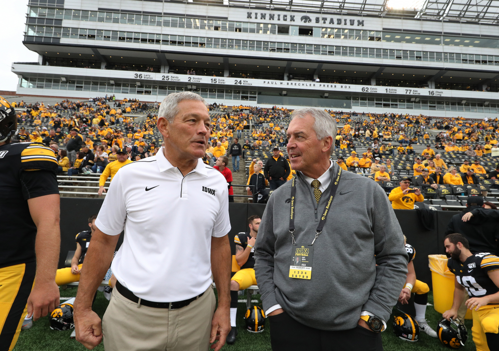 Iowa Hawkeyes head coach Kirk Ferentz and Henry B. and Patricia B. Tippie Director of Athletics Chair Gary Barta against Middle Tennessee State Saturday, September 28, 2019 at Kinnick Stadium. (Brian Ray/hawkeyesports.com)